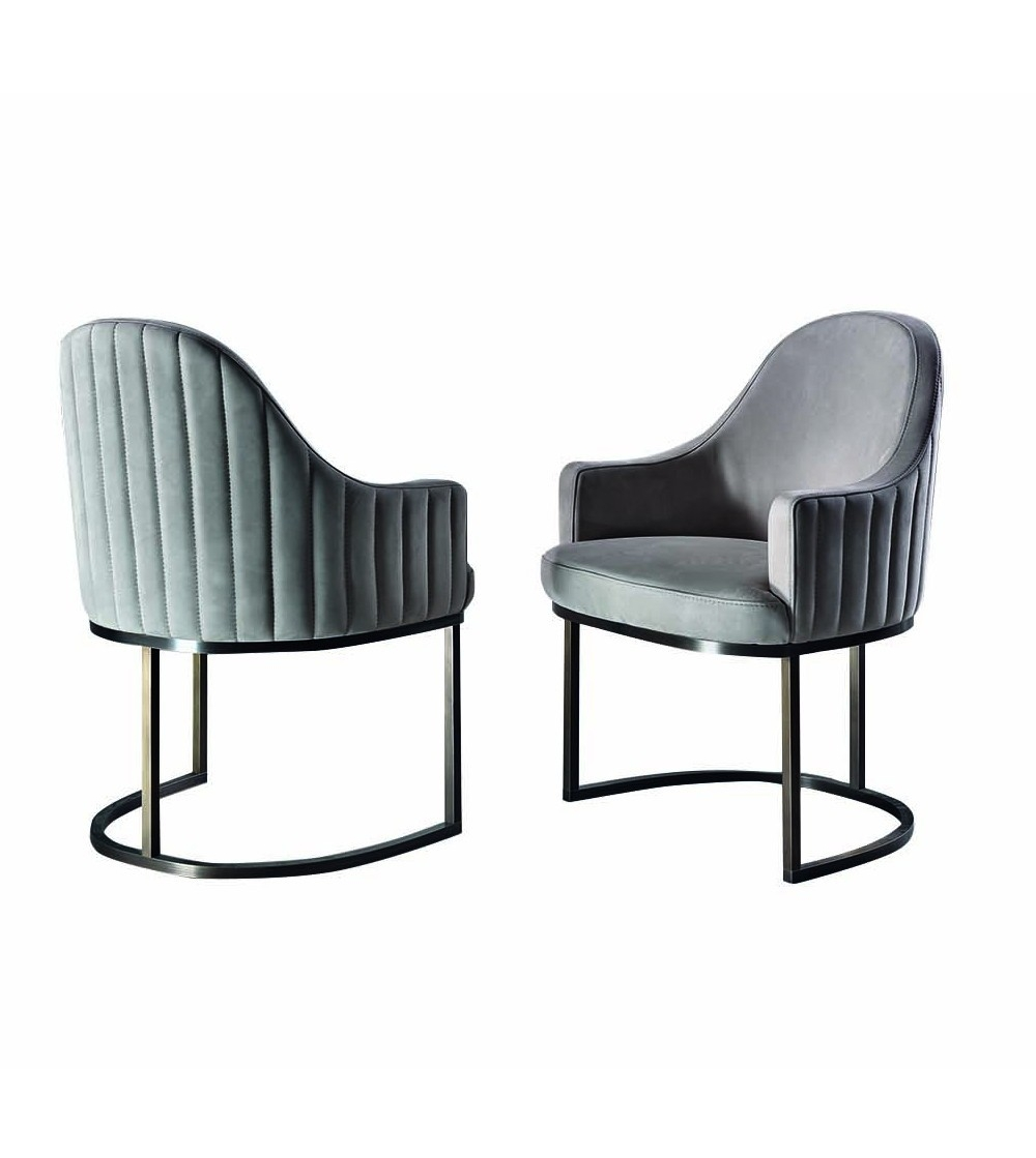 precious modern chair. Isabel Daytona Chair with upholstered in precious nabuk and titanium base  for modern design furniture Comfortable backrest is quilted
